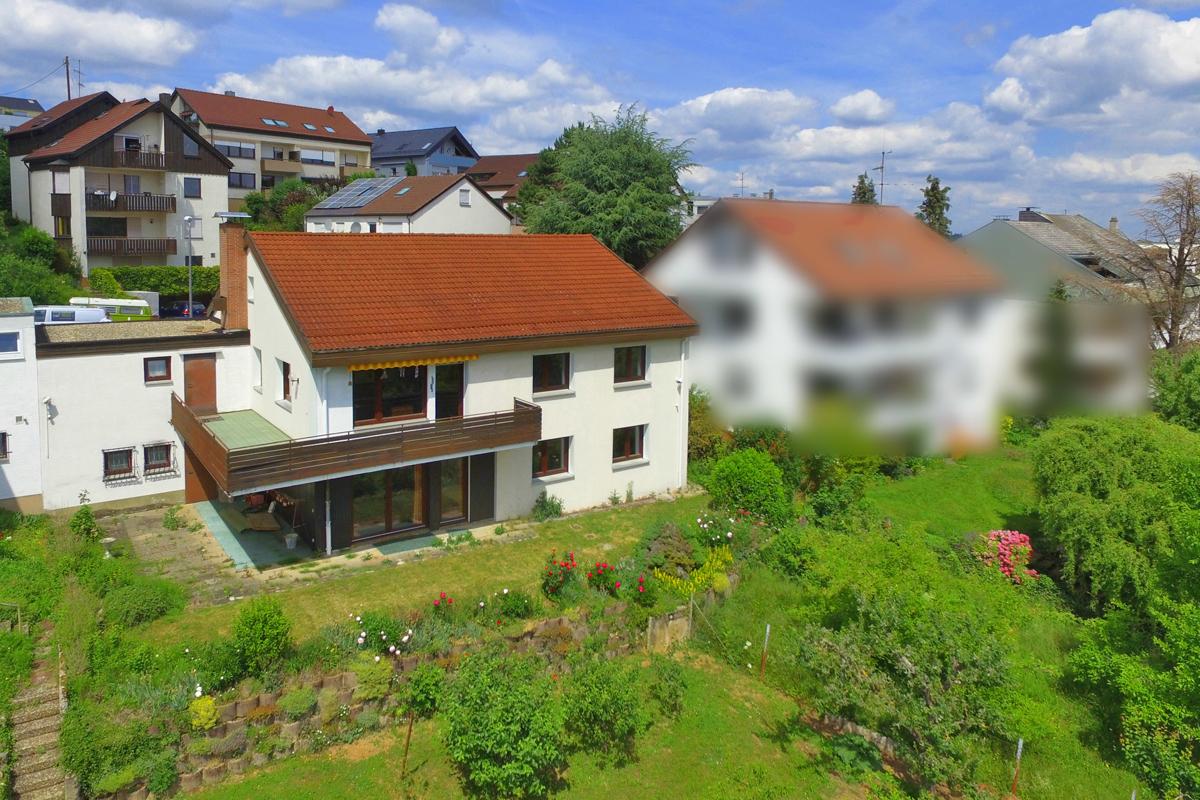 Einfamilienhaus mit Einliegerwohnung in exklusiver Lage